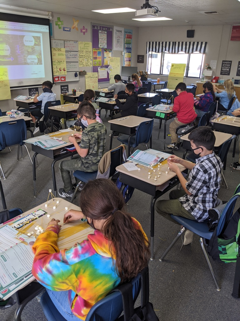 students working on a science activity