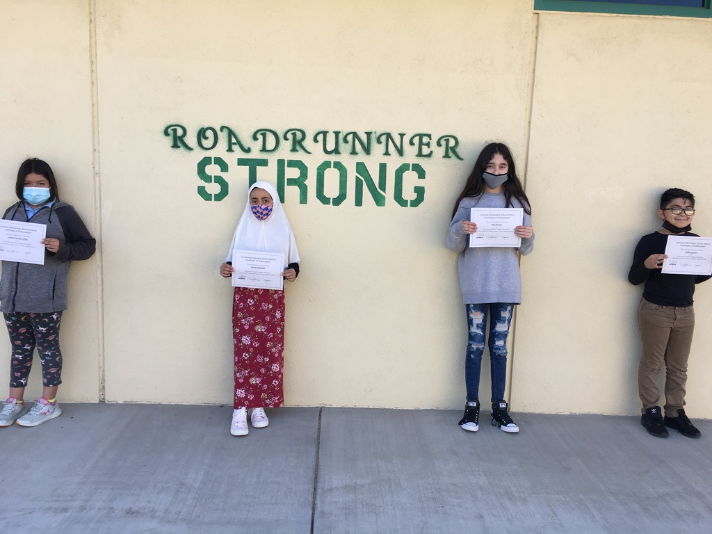 students standing with a certificate