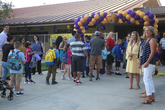 Families drop off their children on the first day of school at Lemoore Elementary School.