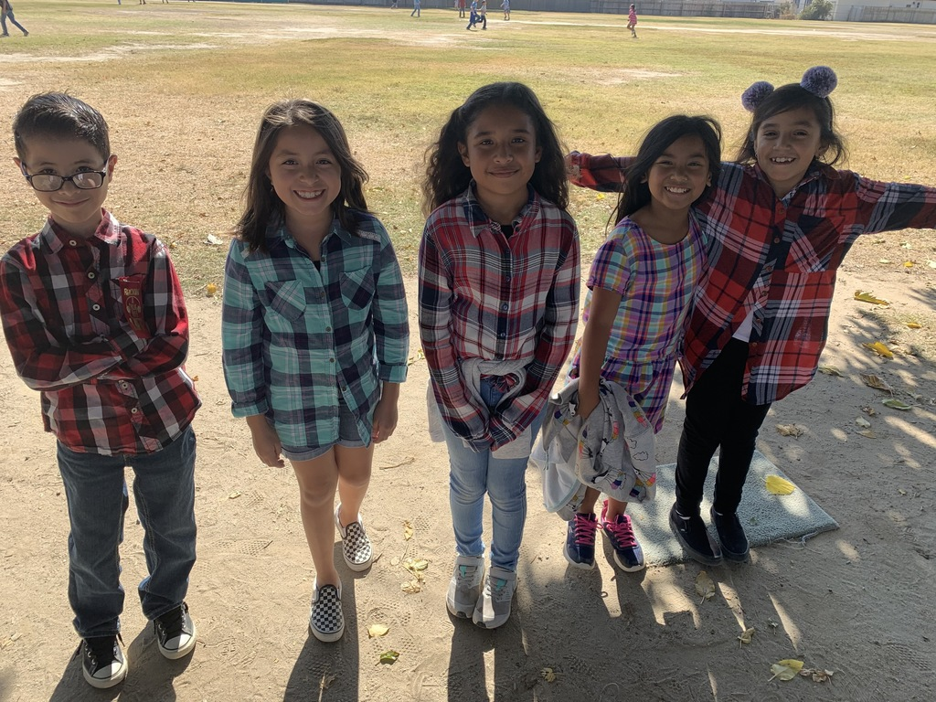 Students showing their plaid shirts.