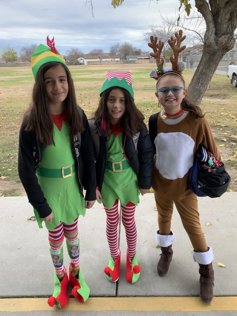 Students dressed up like elves and a reindeer.
