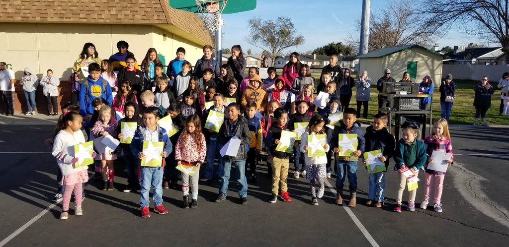 students standing with a certificate.