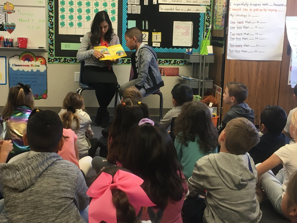 parent reading to class