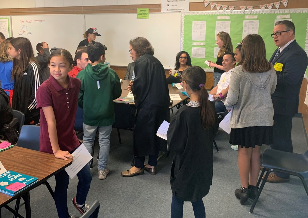 students interviewing community member