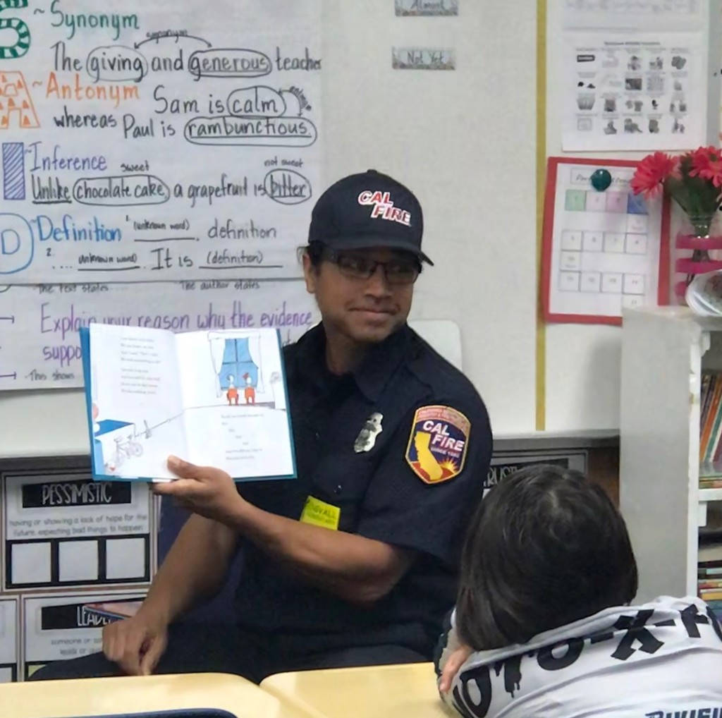 Community Reader in a class reading a book