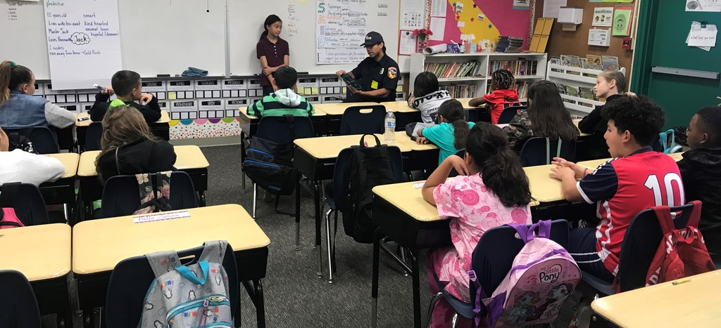 Community member reading to students