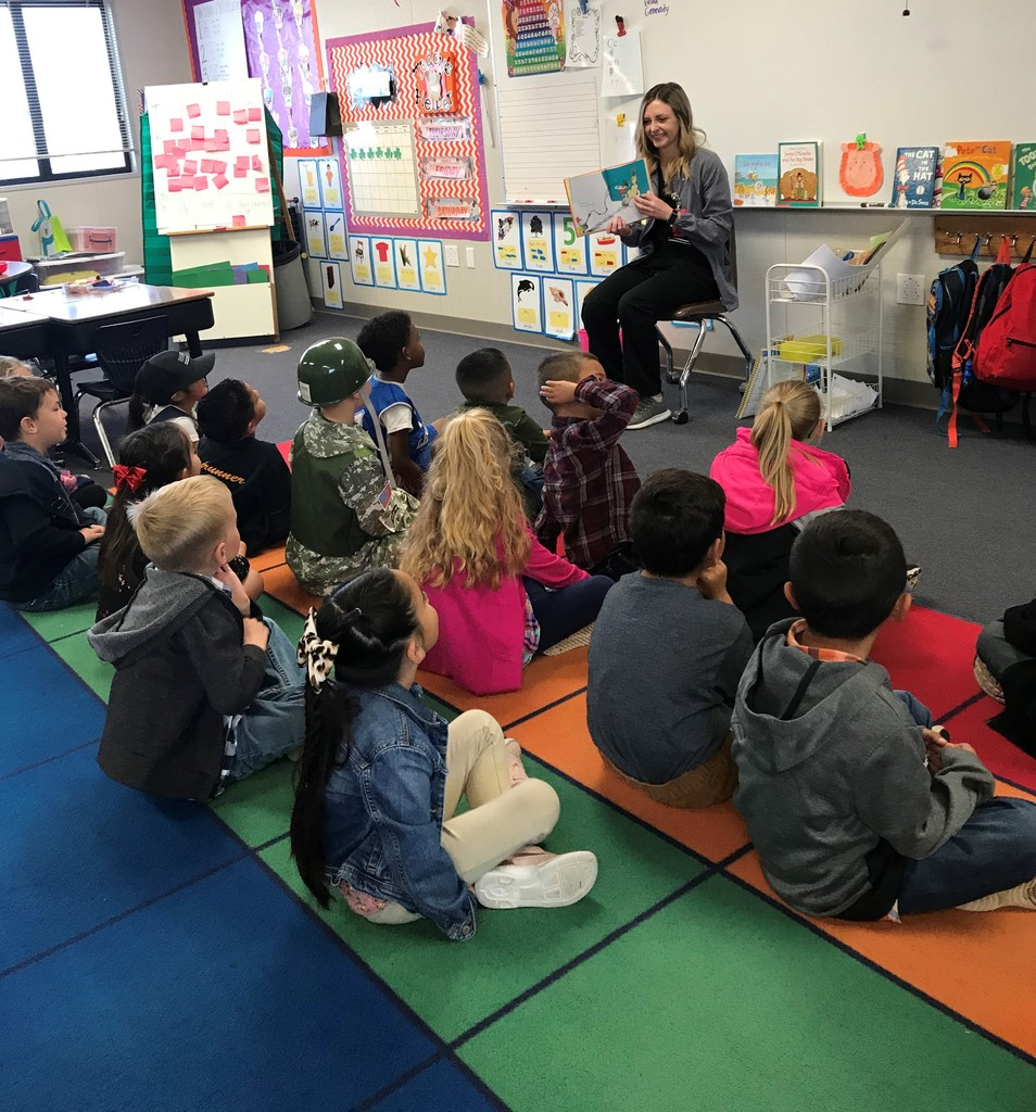 Community Reader reading to students