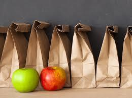 6 brown bag lunches with two apples