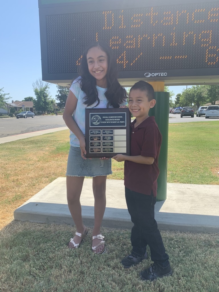 Brandie and her brother Raymond holding the AR plaque